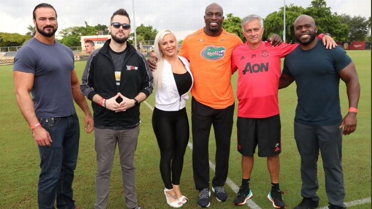 Manchester United manager Jose Mourinho almost manages a smile when meeting the WWE superstars