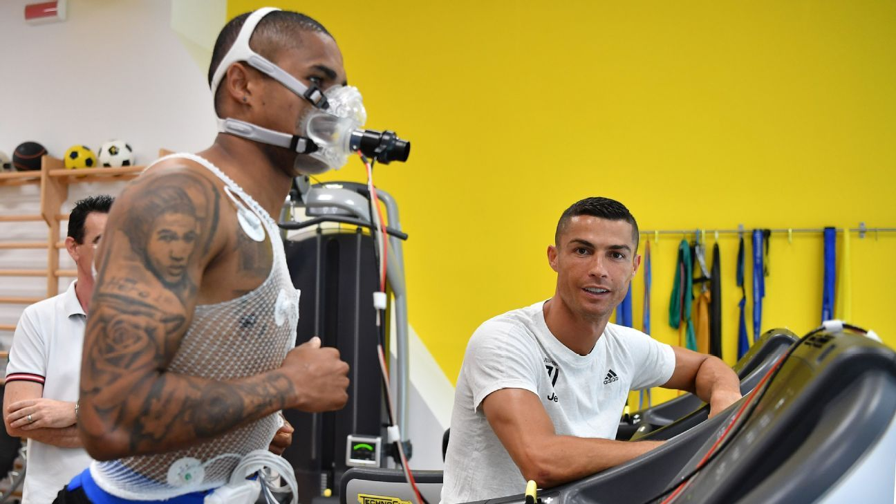 Douglas Costa undergoes medical tests alongside new Juventus teammate Cristiano Ronaldo.