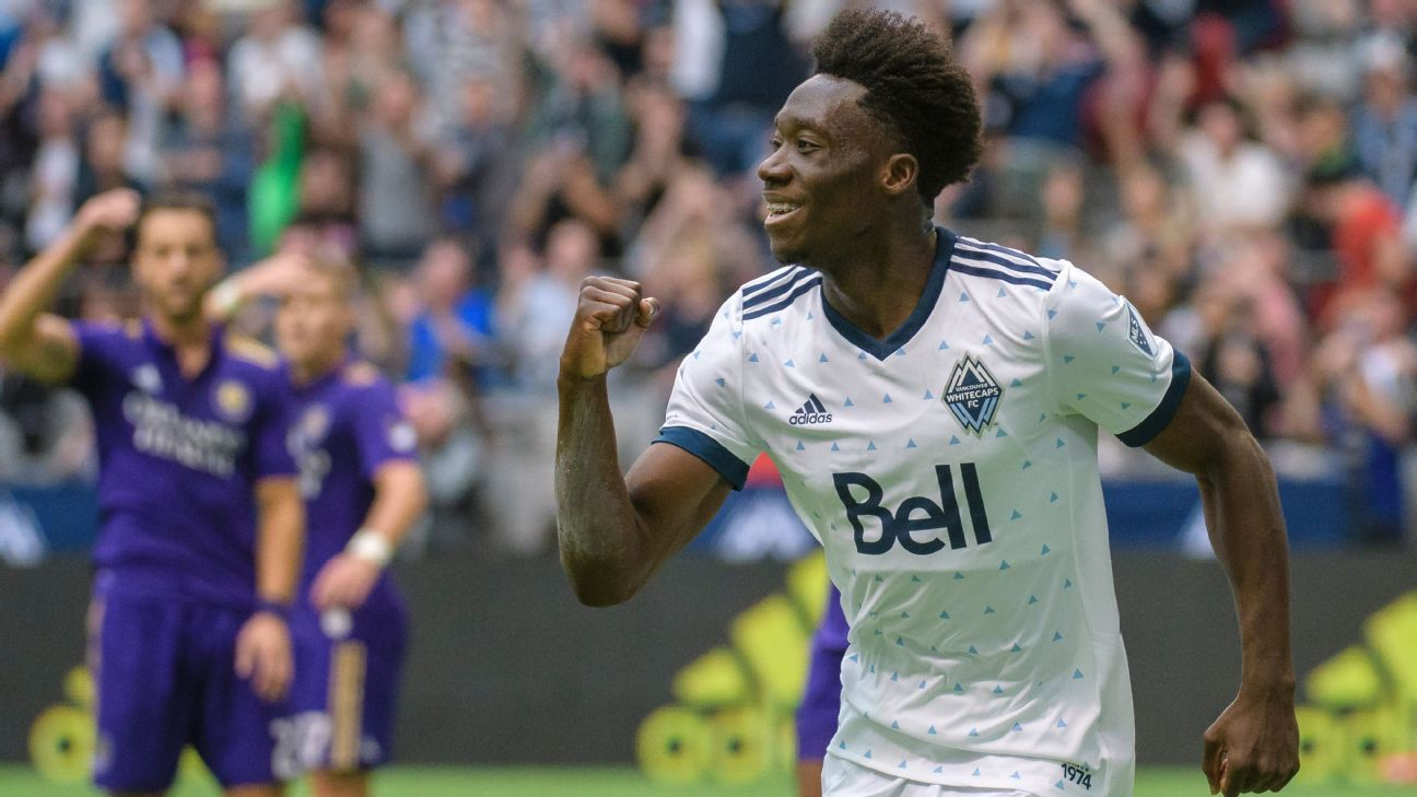 The Vancouver Whitecaps' Alphonso Davies celebrates after scoring against Orlando City.