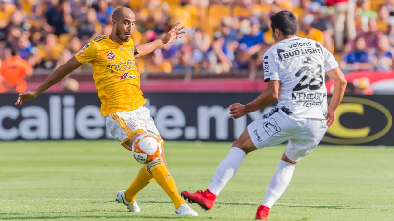Guido Pizarro makes a tackle for Tigres in a match against Tijuana.