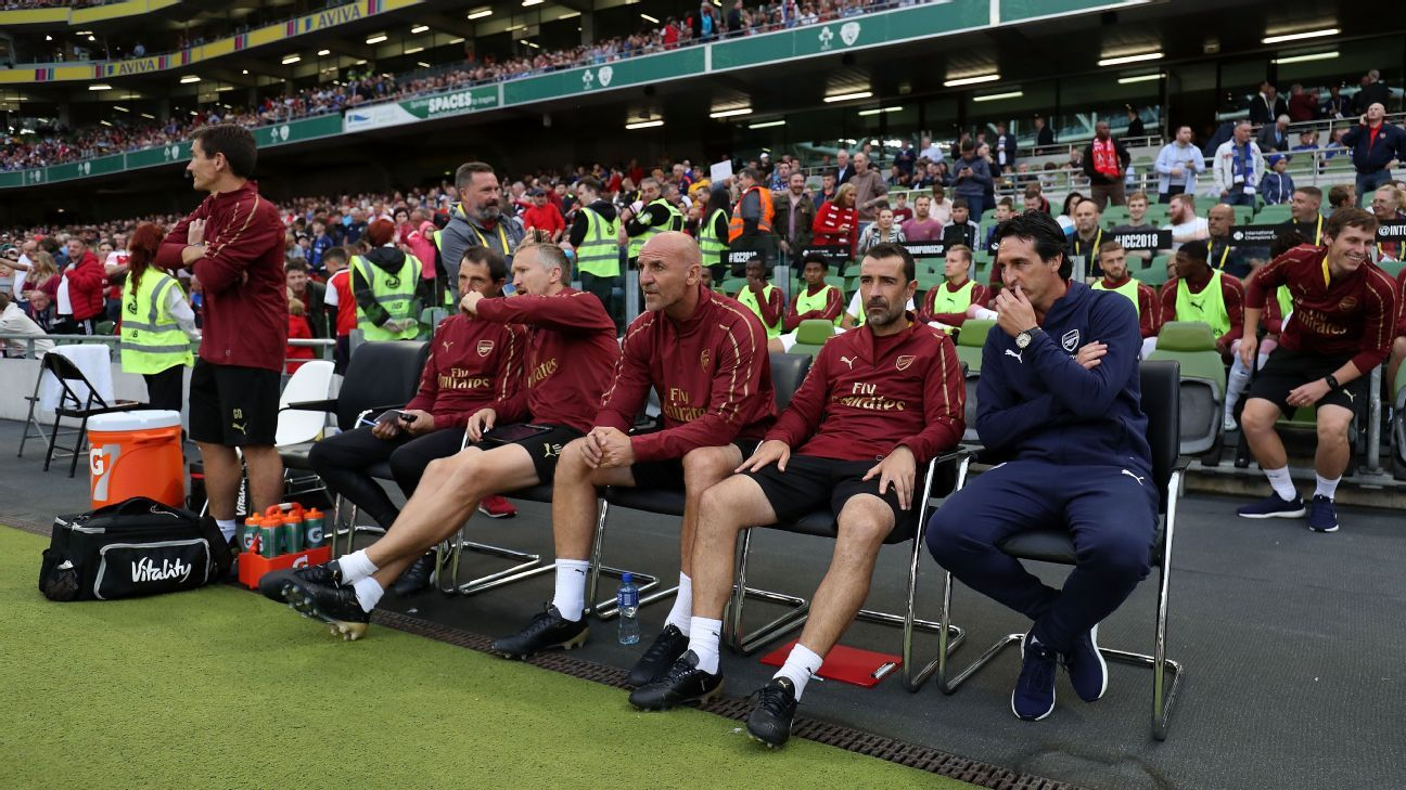 Unai Emery watches on ahead of Arsenal's friendly against Chelsea.