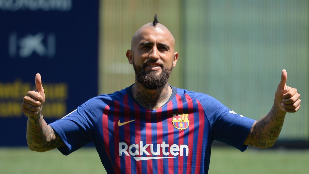 Barcelona's Arturo Vidal poses after his presentation at the Camp Nou.
