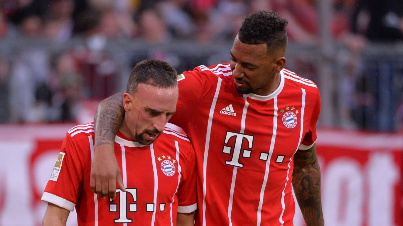 Bayern Munich's Franck Ribery, left, celebrates scoring a goal with Jerome Boateng.