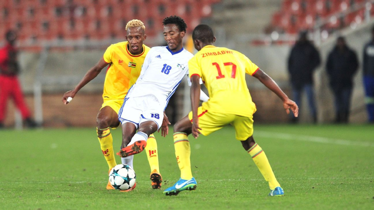 Lesotho's Tumelo Khutlang is challenged by Divine Lunga (left) and Terrence Dzvukamanja of Zimbabwe during the Cosafa Cup, where all three convinced their new PSL clubs to sign them