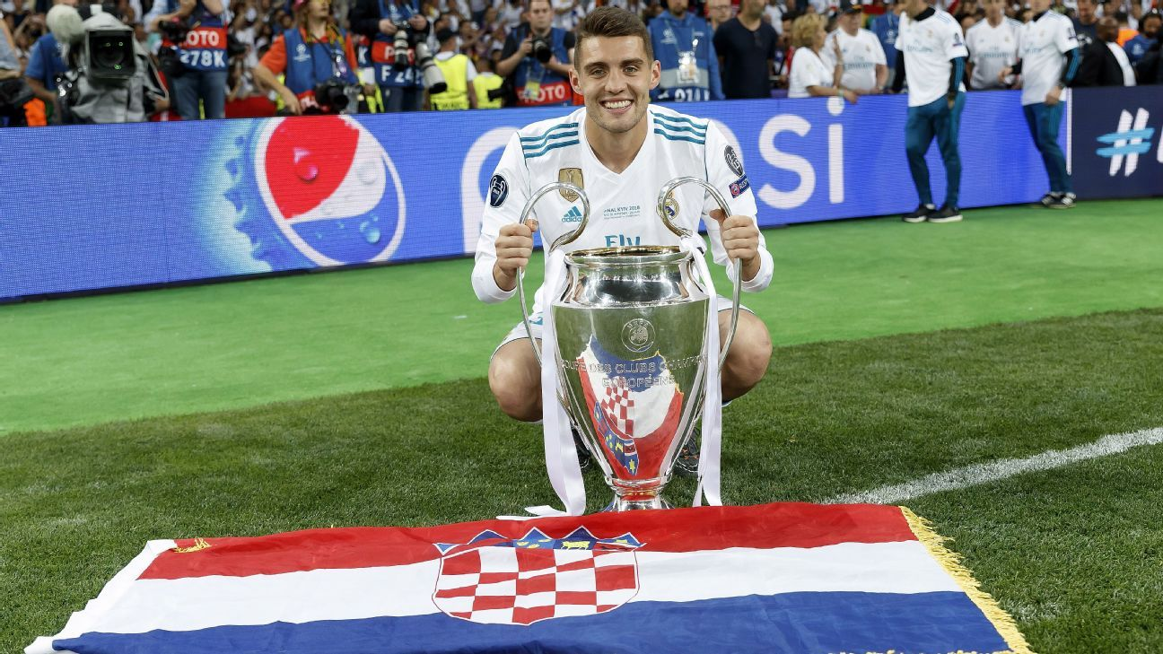 Real Madrid's Mateo Kovacic with the Champions League trophy.