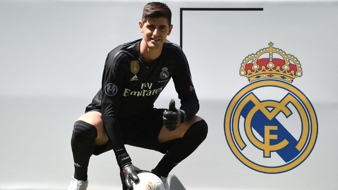 Thibaut Courtois poses for a photo following his presentation by Real Madrid.