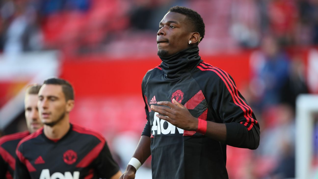 Paul Pogba warms up ahead of Manchester United's Premier League match vs. Leicester City.