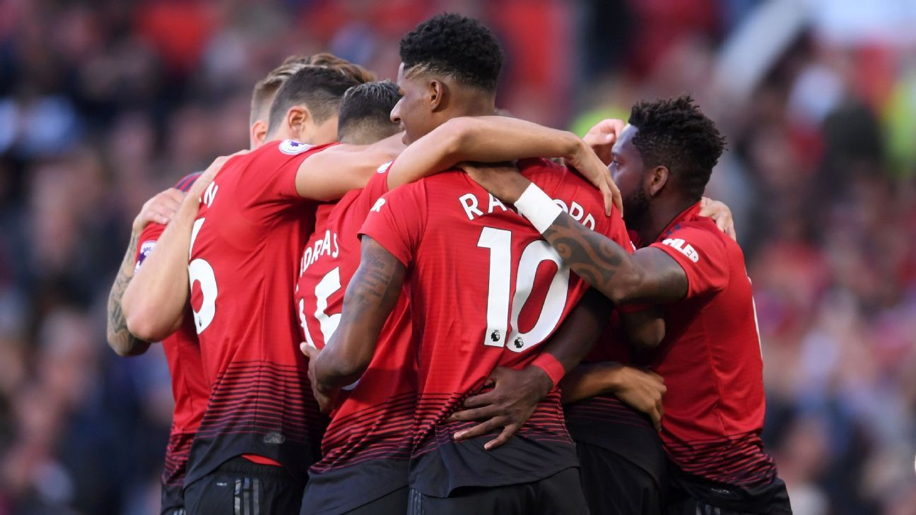 Manchester United celebrate scoring in their Premier League match vs. Leicester City.