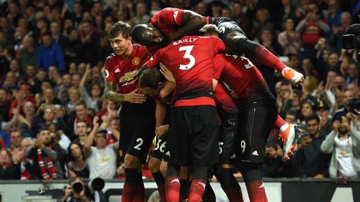 Manchester United players celebrate their second in a 2-1 season-opening win over Leicester.