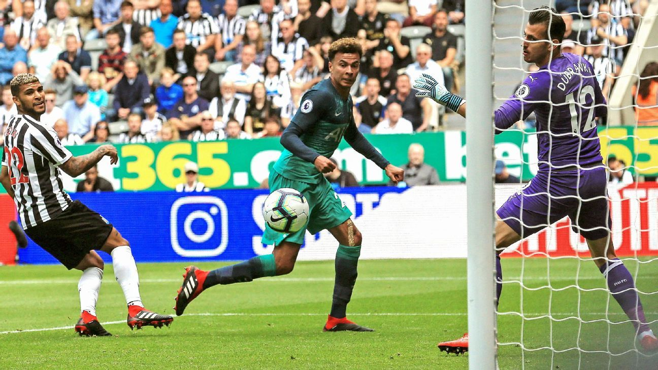 Dele Alli (C) watches the ball into the net after scoring his team's second goal at Newcastle.