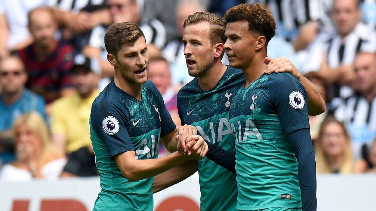Dele Alli of Tottenham Hotspur celebrates with teammates Harry Kane and Ben Davies.