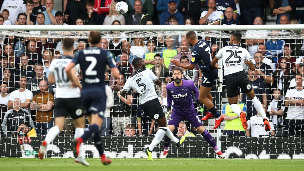 Kemar Roofe (second right) scores his side's second goal of the game.