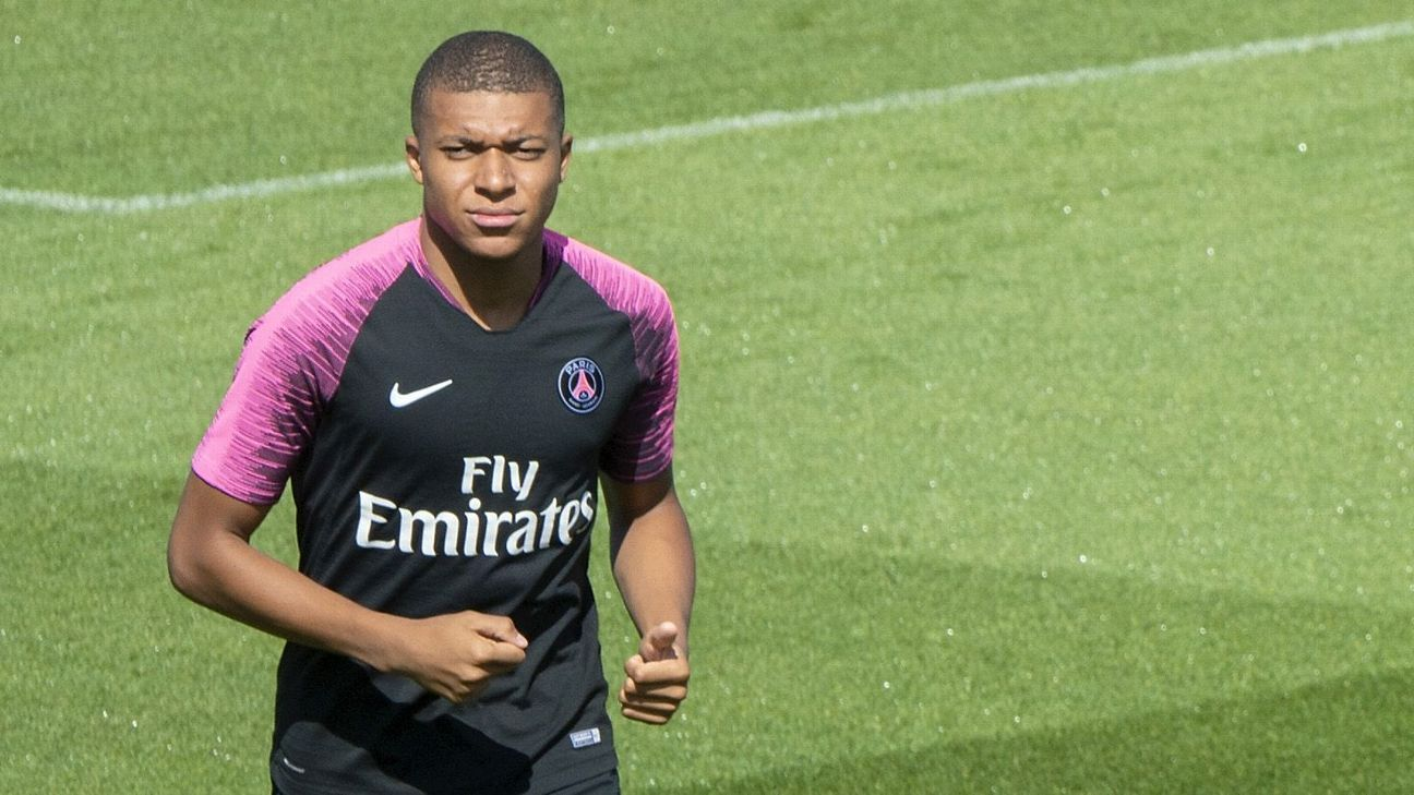 Paris Saint-Germain's Kylian Mbappe warms up during a training session.
