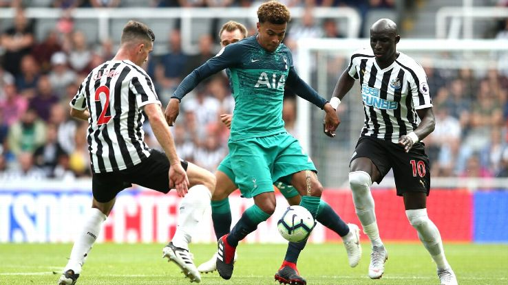 Tottenham Hotspur's Dele Alli is challenged by Newcastle United's Ciaran Clark, left, and Mohamed Diame.