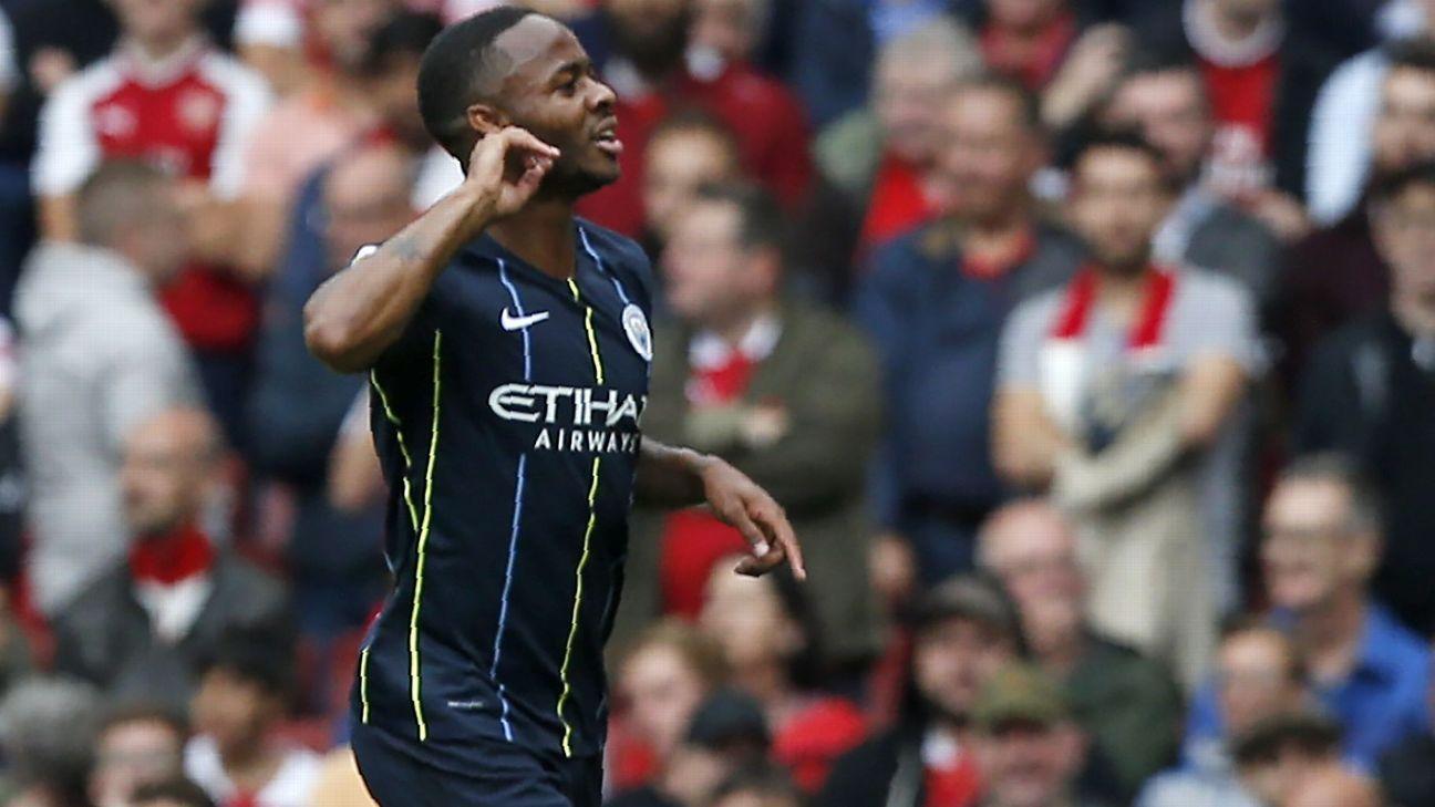 Raheem Sterling celebrates after scoring Man City's opener against Arsenal.