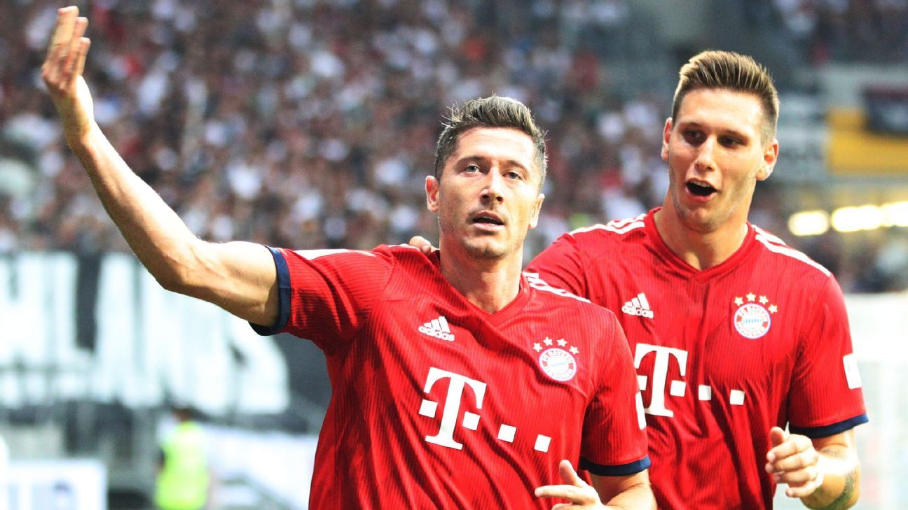 Bayern Munich's Robert Lewandowski celebrates his second of three goals vs. Frankfurt.