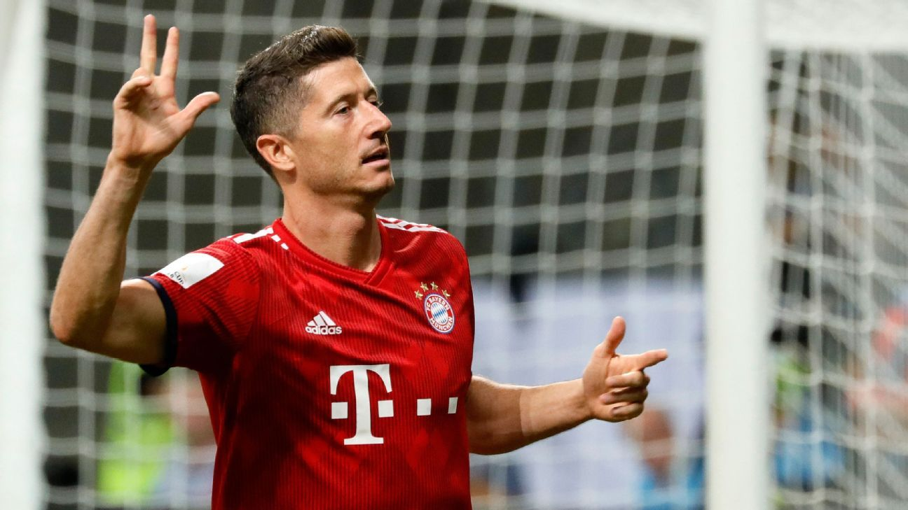 Bayern Munich's Robert Lewandowski celebrates his hat trick against Eintracht Frankfurt.