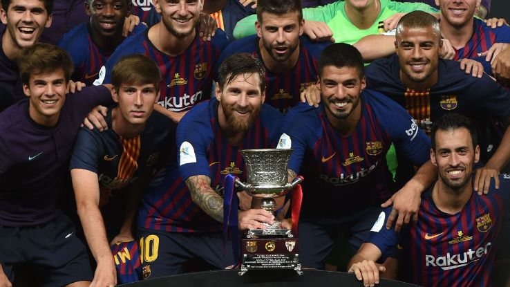 Barcelona won their record 13th Spanish Super Cup with a 2-1 win on Sunday over Sevilla.