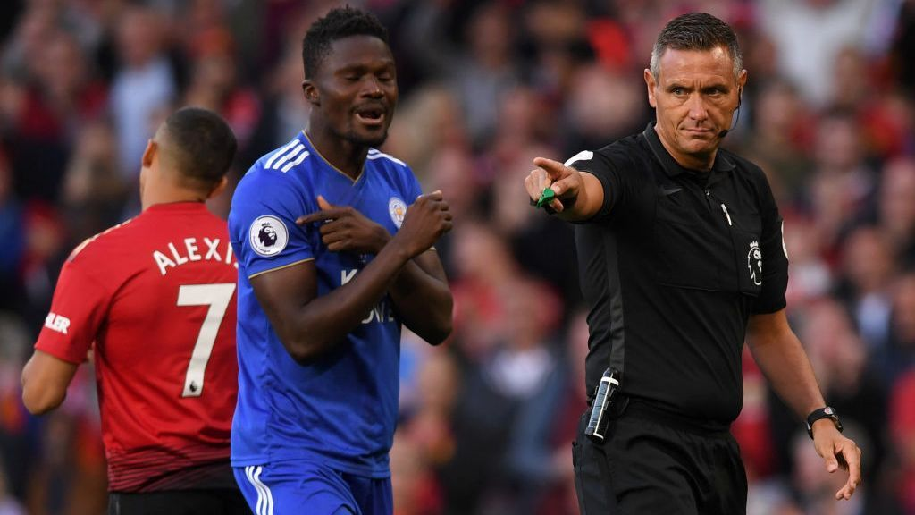 Referee Andre Marriner signs for a penalty after a Daniel Amartey handball during the Premier League match between Manchester United and Leicester City at Old Trafford on August 10.