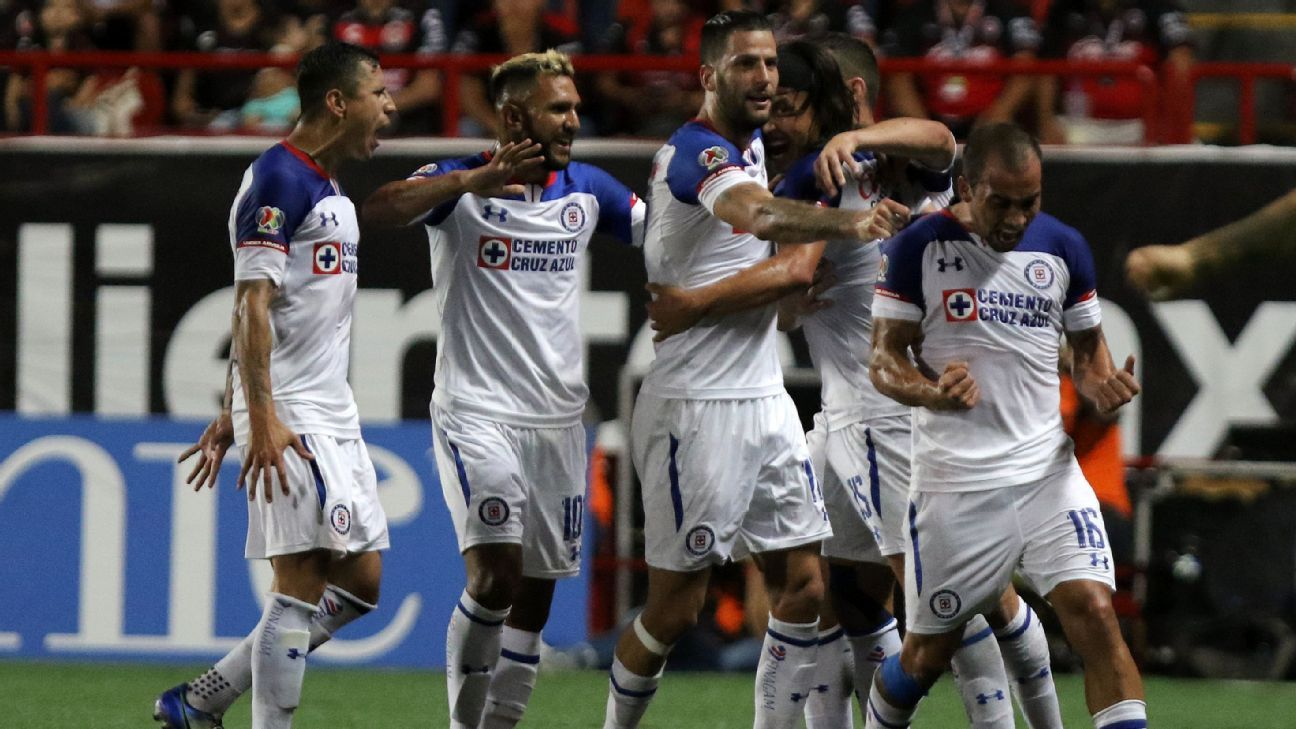 Cruz Azul players celebrate in their Liga MX draw with Tijuana.