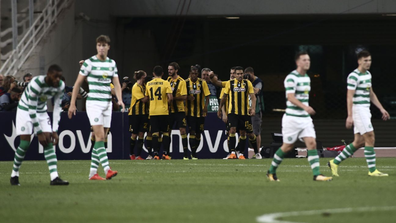 Celtic players react after a AEK Athens goal in a Champions League qualifying match.