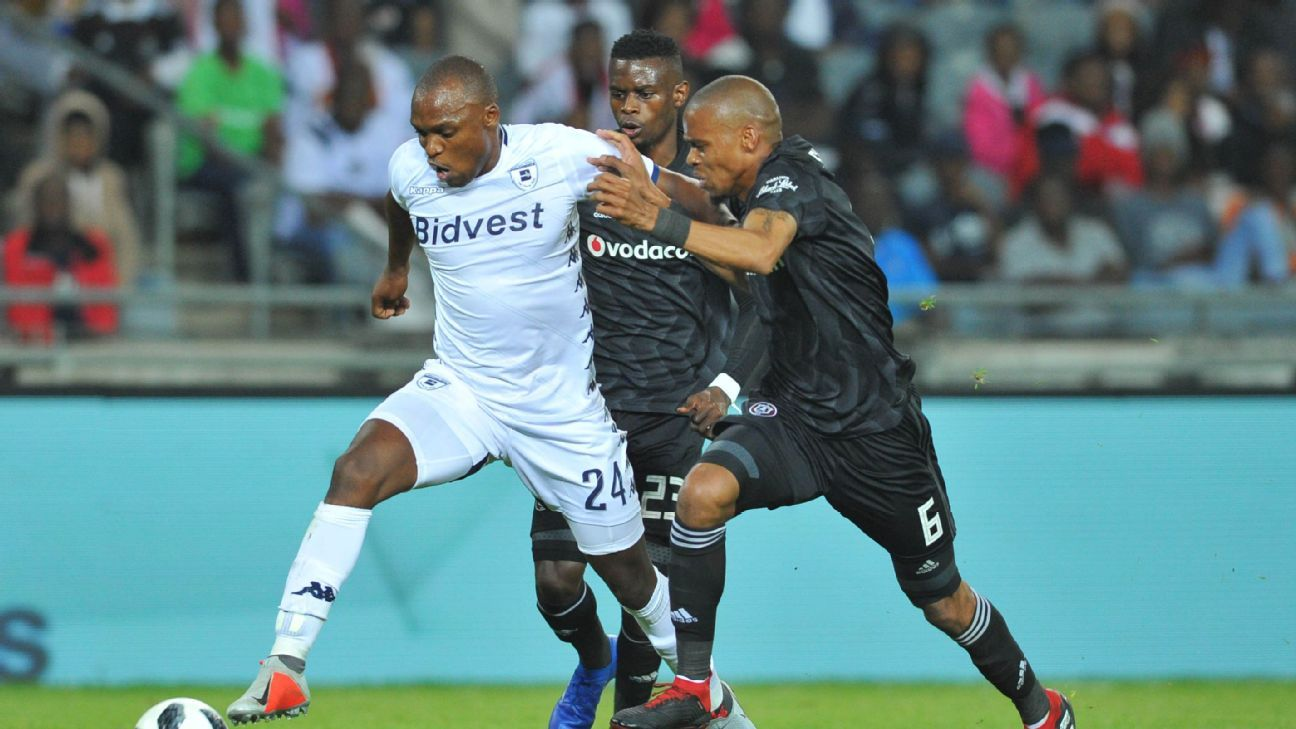 Gladwin Shitolo of Orlando Pirates tackles Gift Motupa of Bidvest Wits