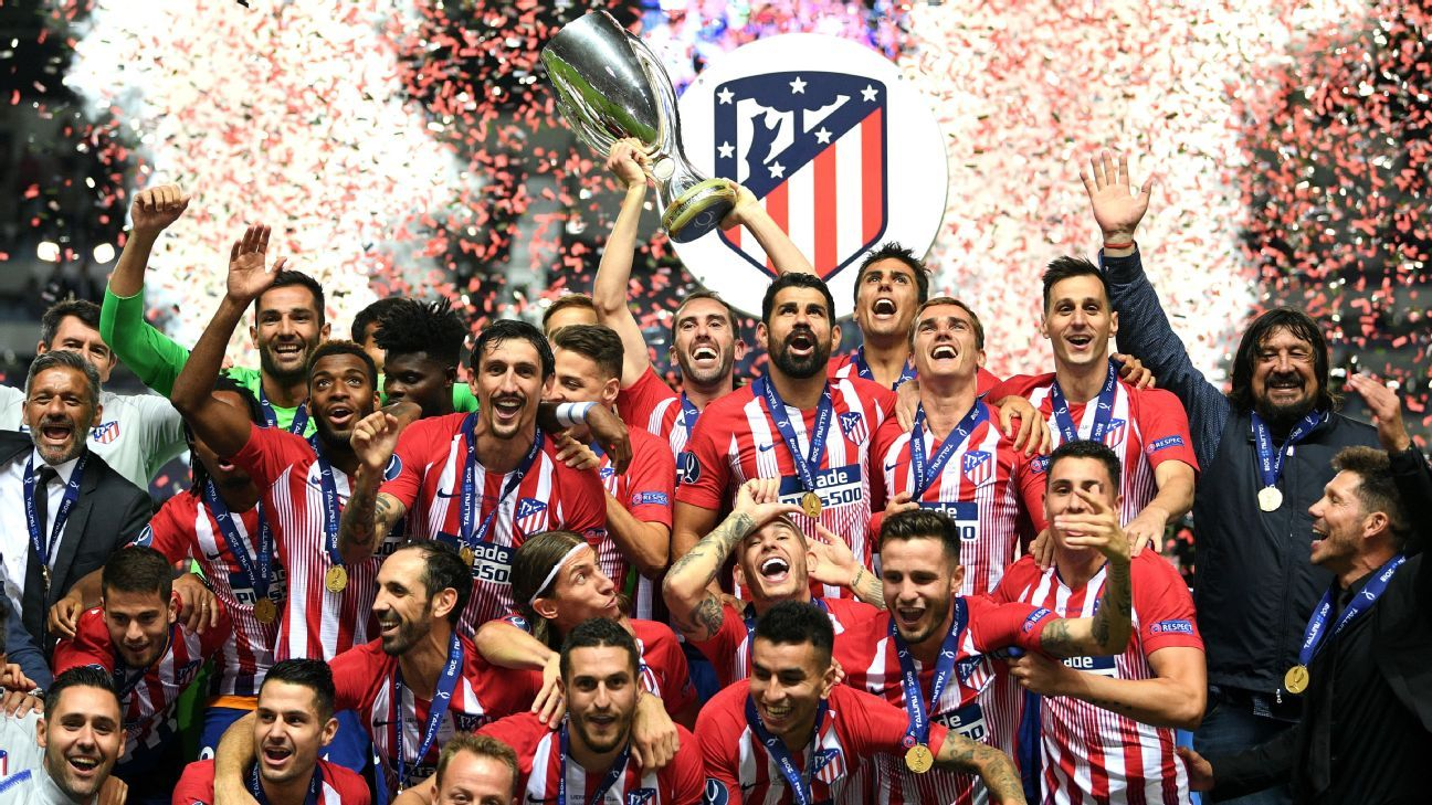 Diego Godin of Atletico Madrid lifts the UEFA Super Cup.