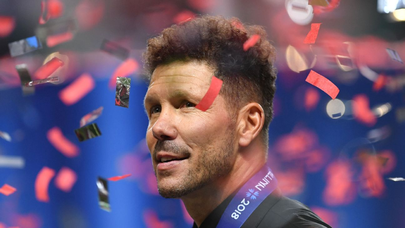 Atletico Madrid manager Diego Simeone celebrates winning the UEFA Super Cup.