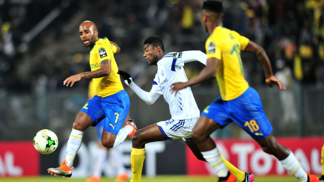 Oupa Manyisa of Mamelodi Sundowns challenged by Efoe Yao Novon of AS Togo Port during their 2018 CAF Champions League match.