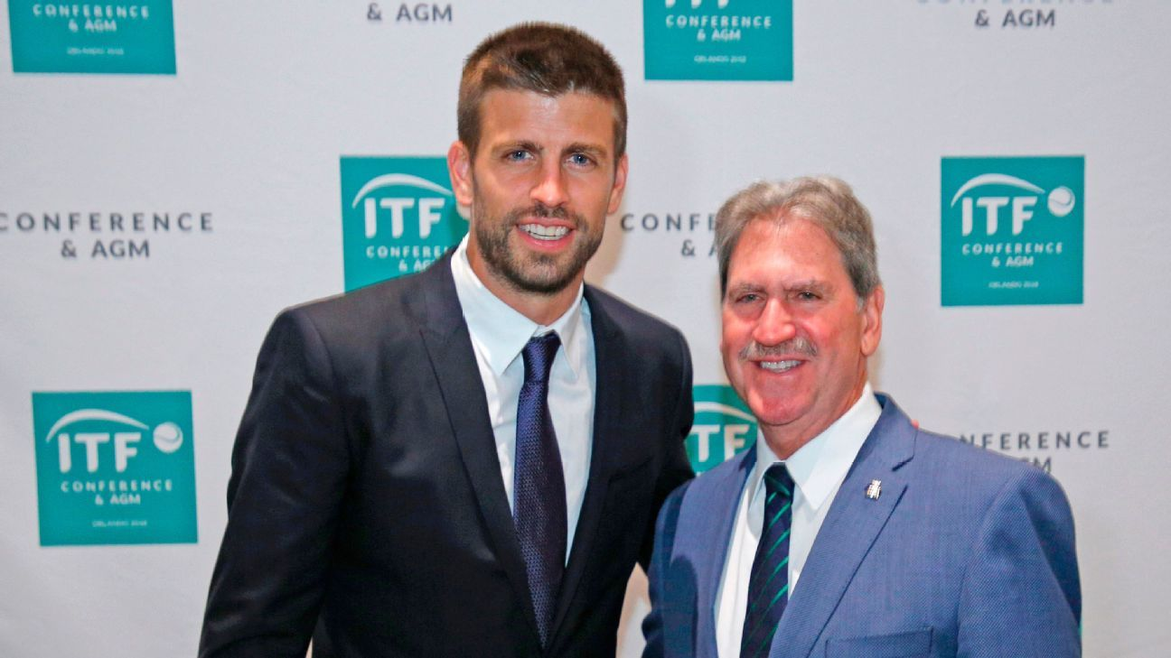 David Haggerty, President of the International Tennis Federation poses with Barcelona's Gerard Pique