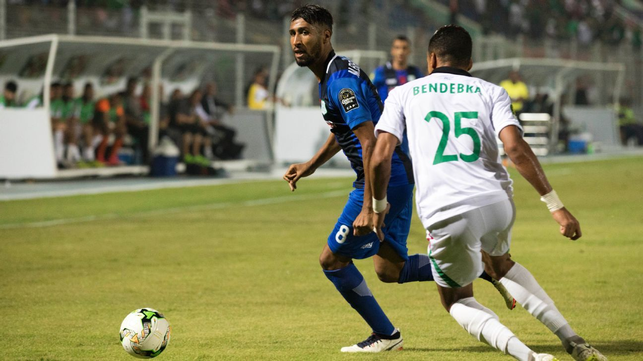 Mohammed Ali Bemammer of Difaa Hassani El Jadidi (R) and Mouloudia Club Alger player Bendebka Sofiane (L) fight for the ball
