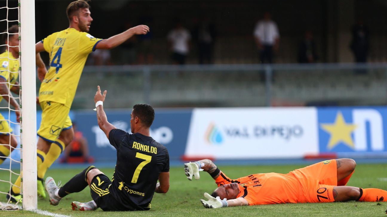 Cristiano Ronaldo comes down heavily on Chievo goalkeeper Stefano Sorrentino.