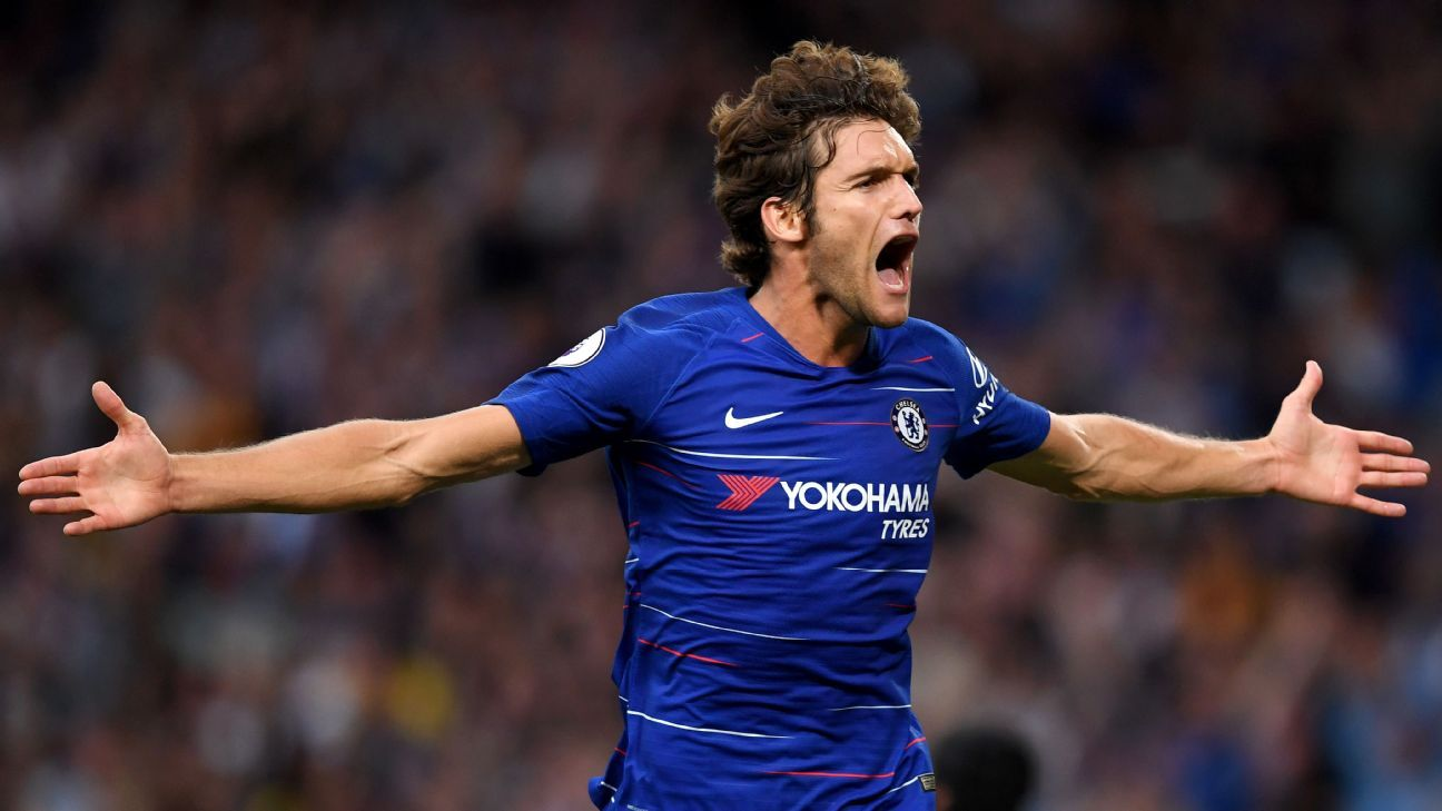 Marcos Alonso celebrates scoring in Chelsea's Premier League win over Arsenal.