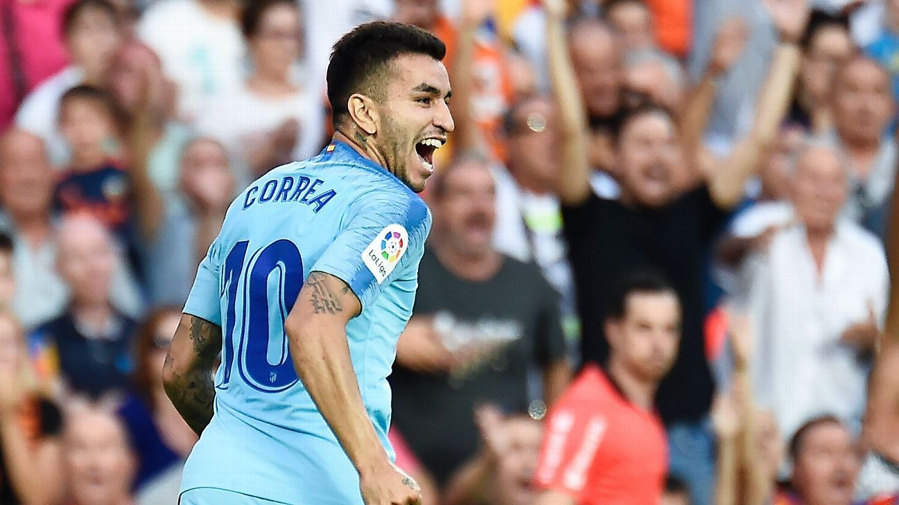 Angel Correa celebrates after scoring a goal for Atletico Madrid.