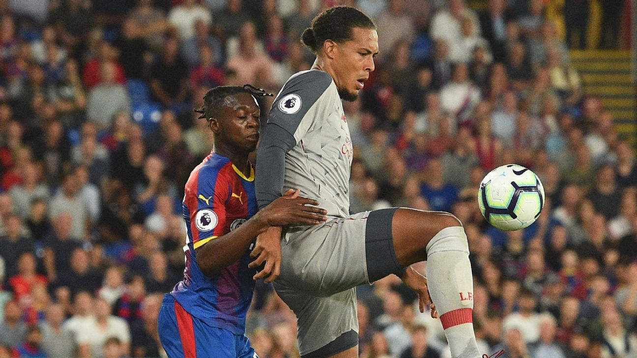 Virgil van Dijk holds off Aaron Wan-Bissaka in Liverpool's 2-0 win over Crystal Palace on Monday.