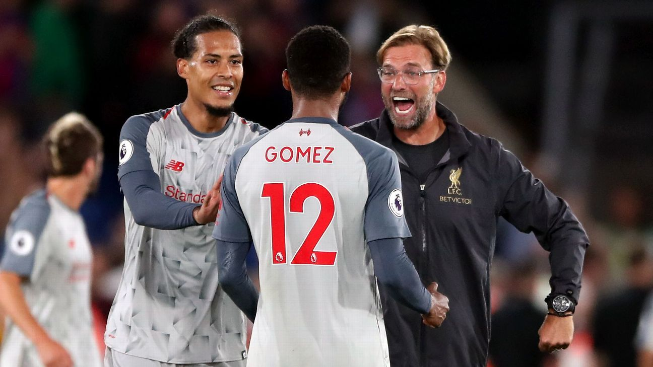 Virgil van Dijk, left, Joe Gomez and Jurgen Klopp celebrate after Liverpool's win against Crystal Palace.