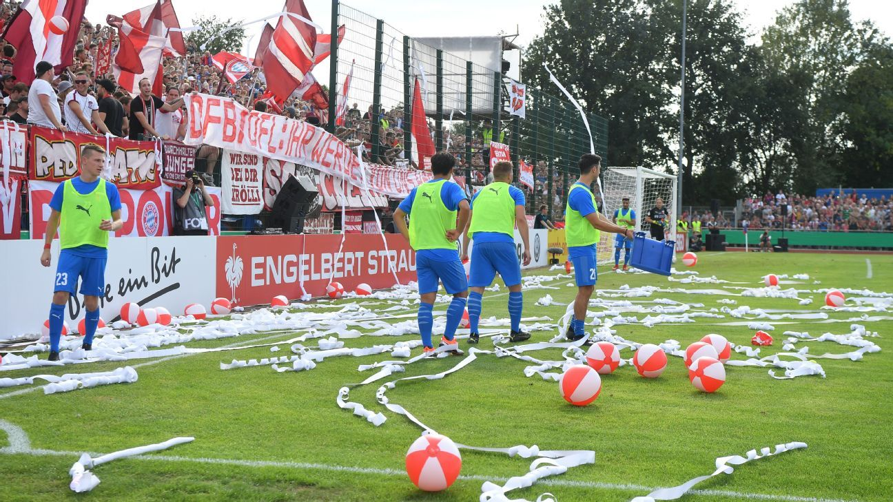 Bayern Munich fans throw paper and balls during the DFB Cup first-round game against Drochtersen.