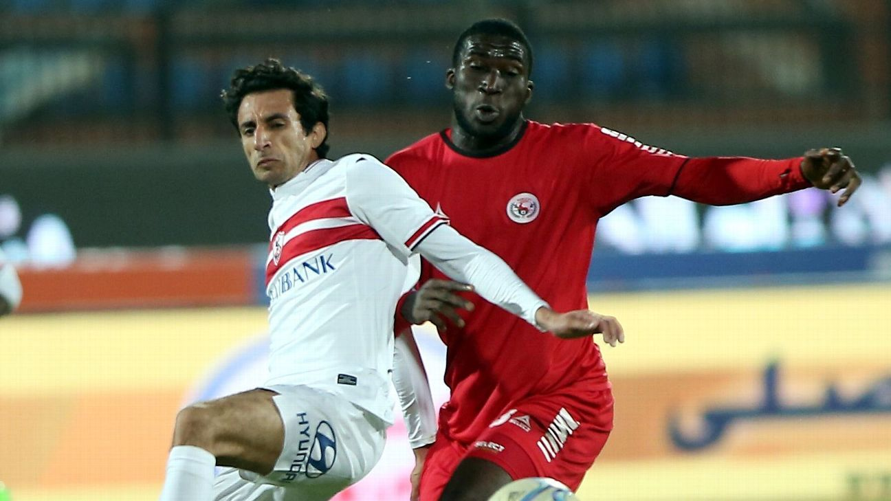 Ayman Hefny of Zamalek battles with Christian Madu of Enugu Rangers