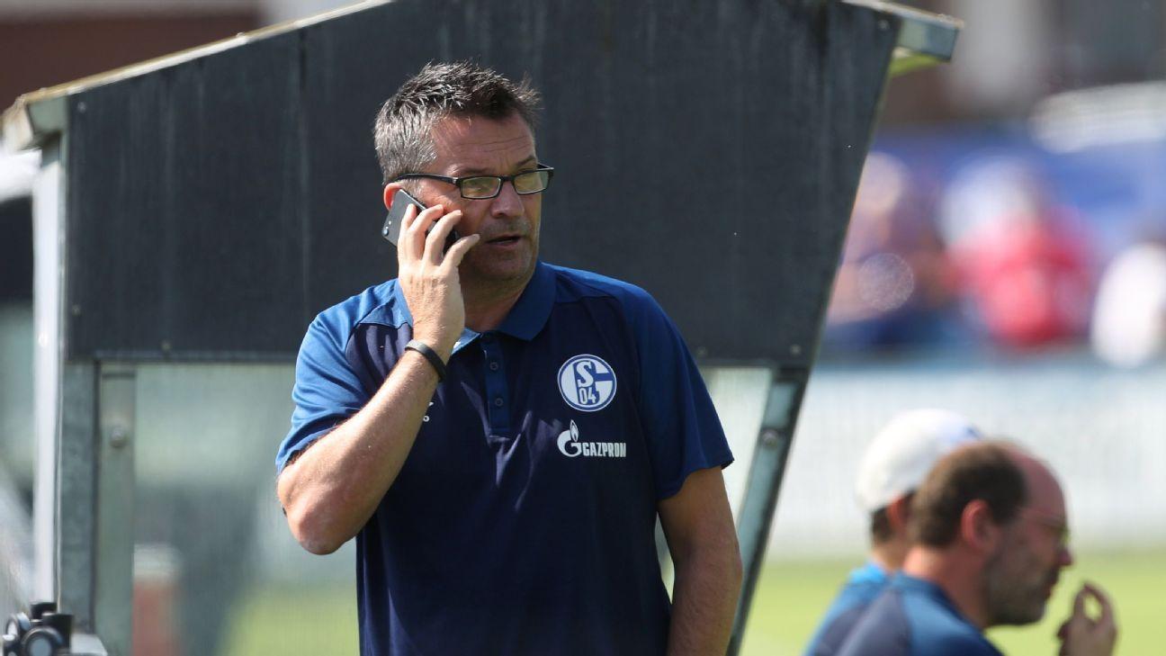 Schalke sporting executive Christian Heidel speaks on the phone.