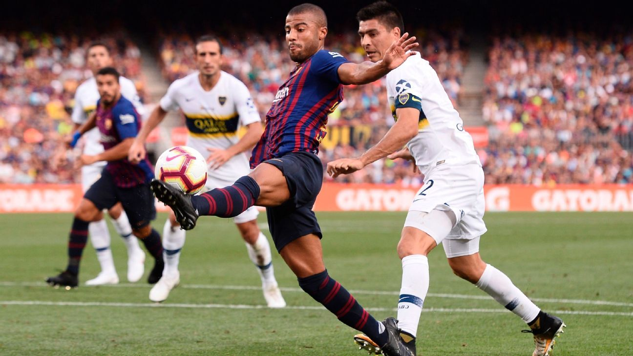 Barcelona midfielder Rafinha cushions a ball against Boca Juniors.