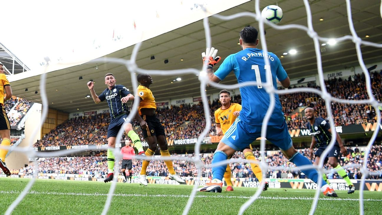 Aymeric Laporte rises to head Man City level at Wolves.