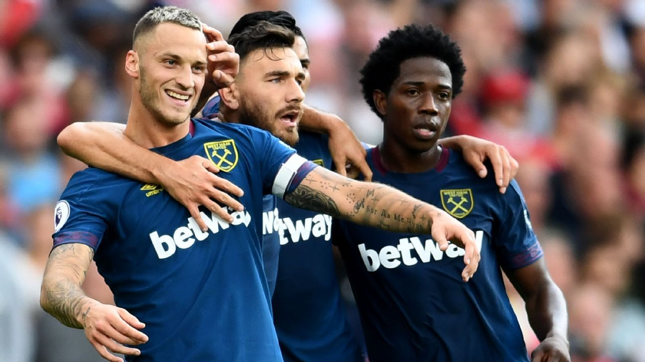 Marko Arnautovic of West Ham United celebrates after scoring at Arsenal.