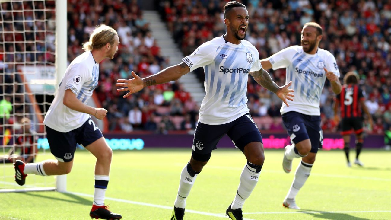 Theo Walcott of Everton celebrates his opener at Bournemouth.