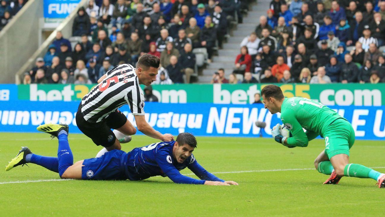 Martin Dubravka collects the ball ahead of Alvaro Morata.