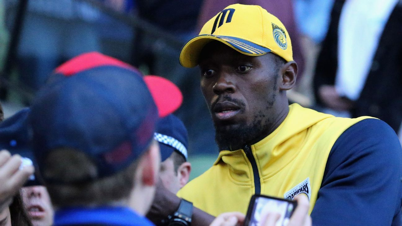 Usain Bolt greets fans at an A-League trial match.