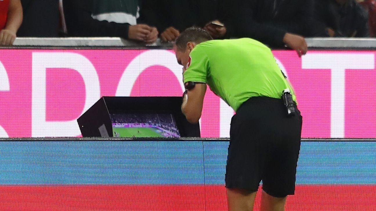 Referee Bastian Dankert views the VAR monitor during the Bundesliga game between Bayern Munich and Hoffenheim.