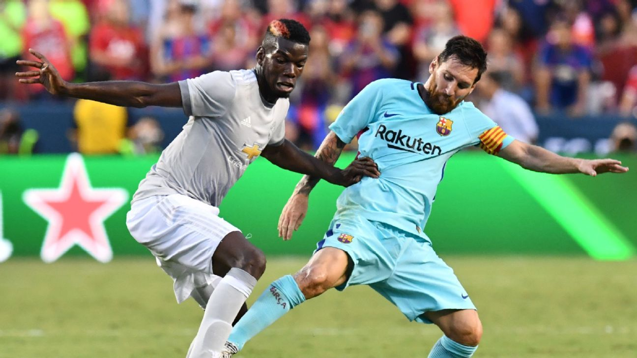 Barcelona's Lionel Messi, right, vies for the ball with Manchester United's Paul Pogba, left.