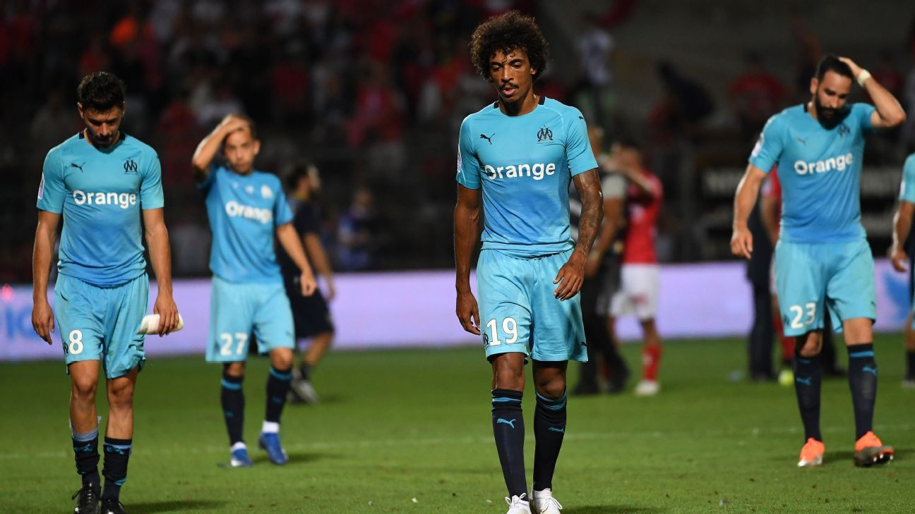 Marseille leave the pitch after being defeated by Nimes.
