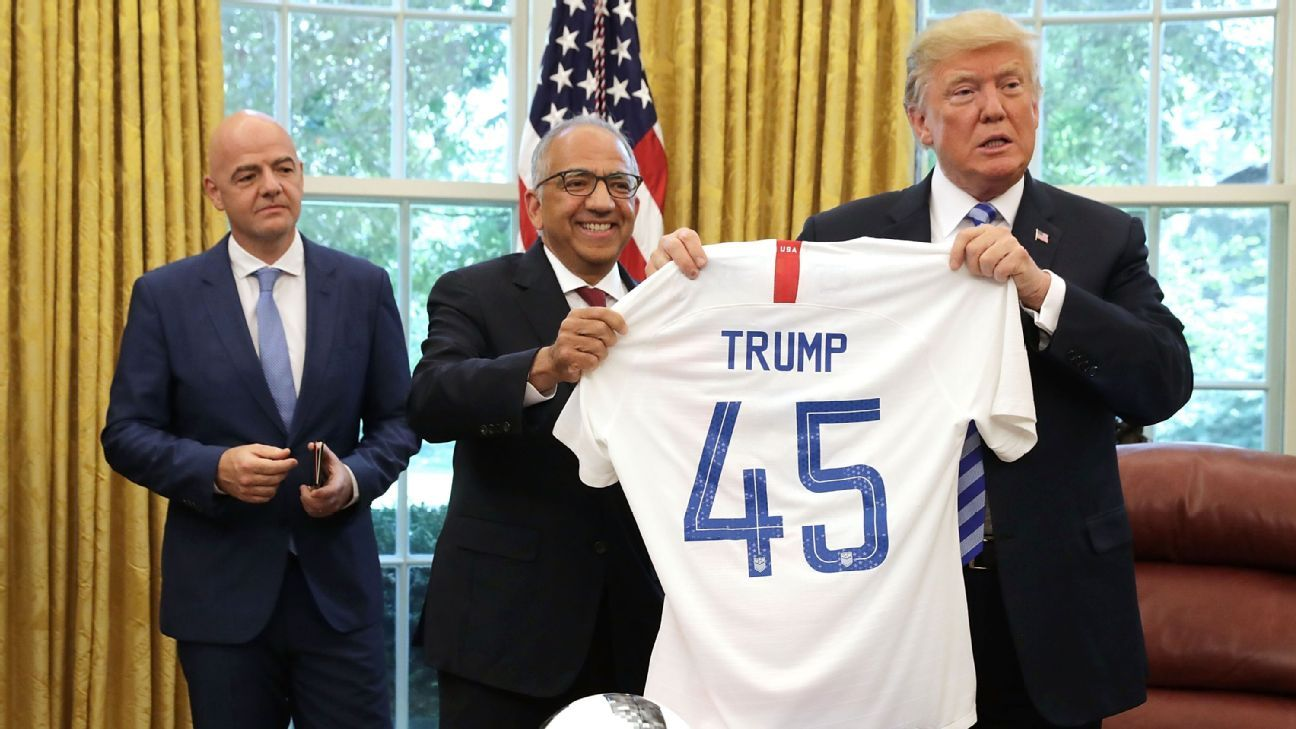 USSF president Carlos Cordeiro presents U.S. President Donald Trump with a jersey.