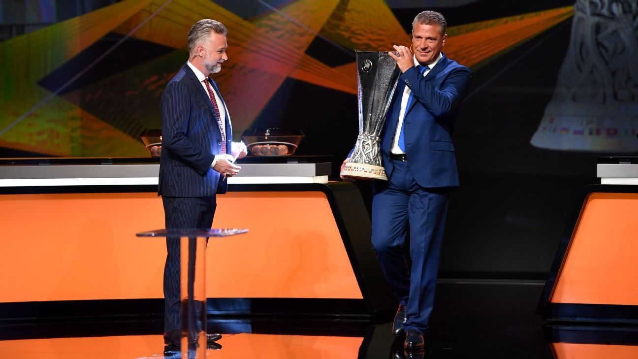 The UEFA Europa League trophy is brought on stage by Vali Gasimov.